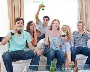 friends-drinking-beer-home-watching-tv-11933054